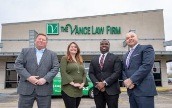 ASU alumnus Brandon Price-Crum, third for left, poses with The Vance Law Firm attorneys