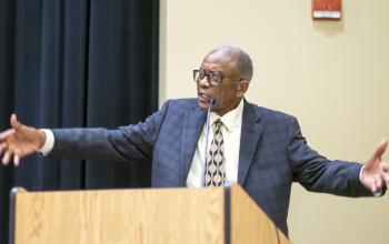 Gray speaking at the Sit-in conference