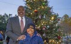 ASU President Dr. Quinton T. Ross and in front of ASU's Christmas Tree